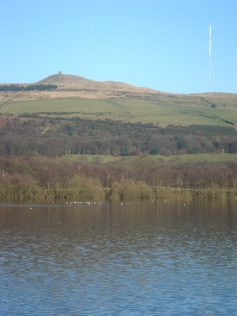 View across Rivington reservoir to Rivington Pike and Winter Hill Transmitter.