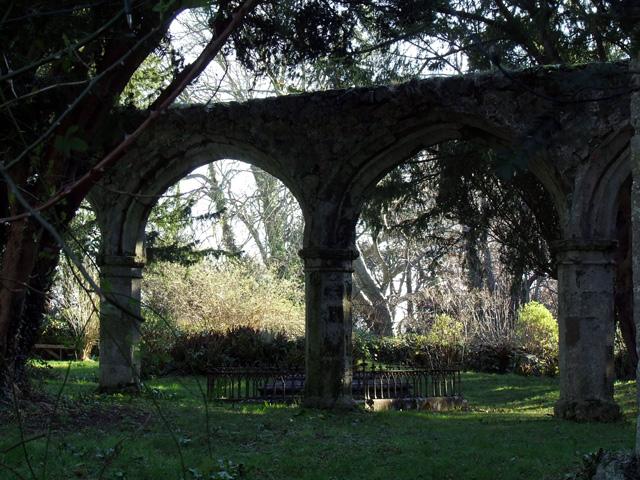 Archways alongside old church