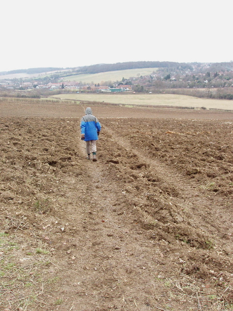 Footpath across ploughed field, with view to Amersham