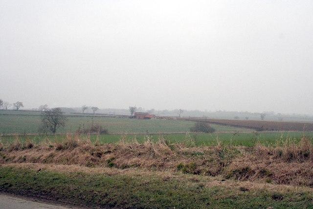 Barns in fields
