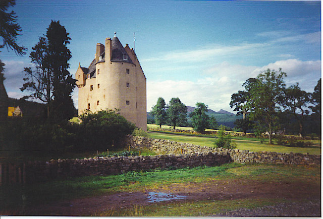 Pitfichie Castle with a distant Bennachie.