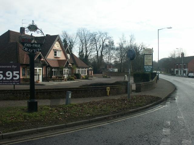 Village sign and pub, Drayton