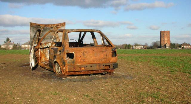 Burned-out car with Water Tower