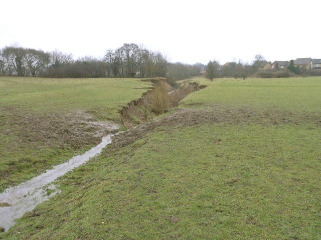 A brook cuts into a field near Borough Green
