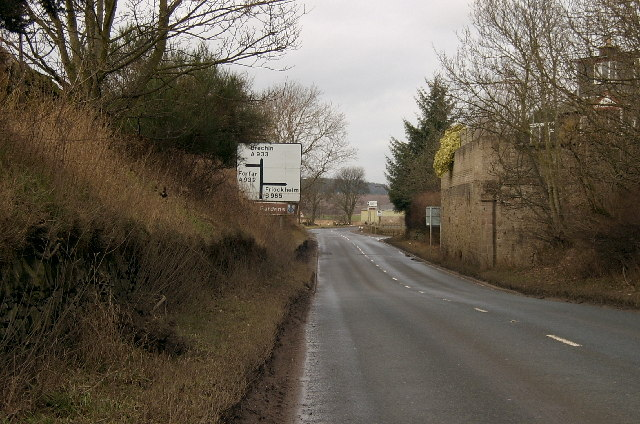Looking to the Friockheim junction on the A933, with disused railway on the right.