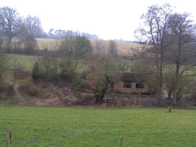 Derelict farm building & fields