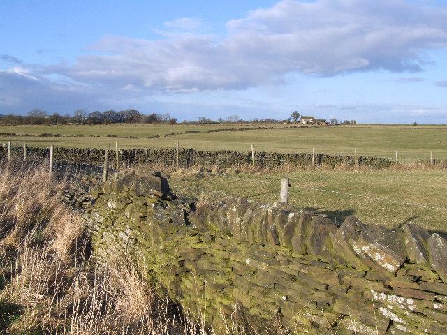 Stone walls and farmland.