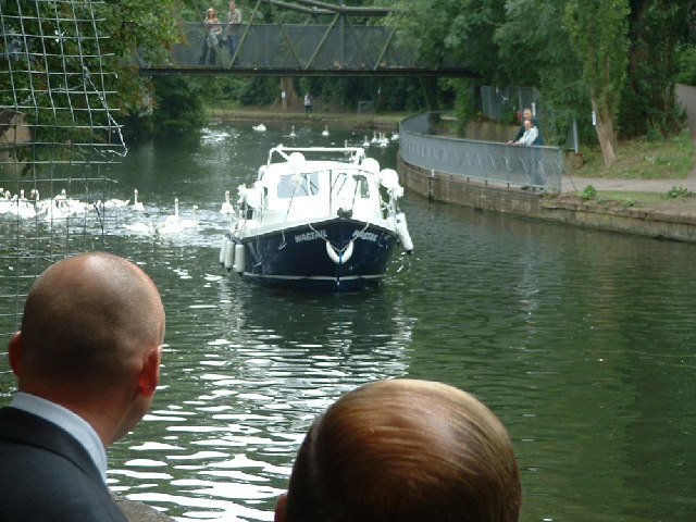 boat on the River Lea arriving at the Priory with the bride for a wedding