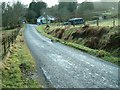 NN0521 : Roadside cottage by Patrick Mackie