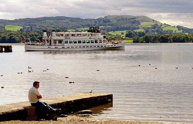 A tour boat leaving Bowness