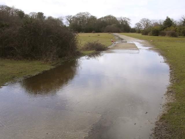 Flooded concrete road on Janesmoor Plain, New Forest