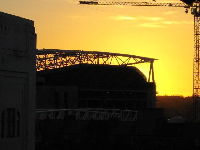 Sun setting behind Stadium at Ashburton Grove
