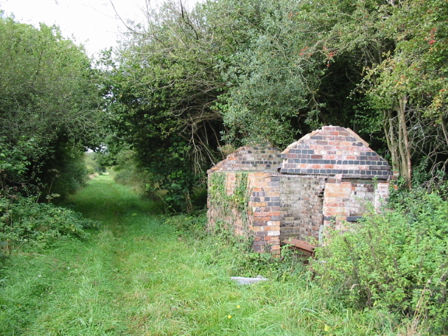 Course of disused railway and building