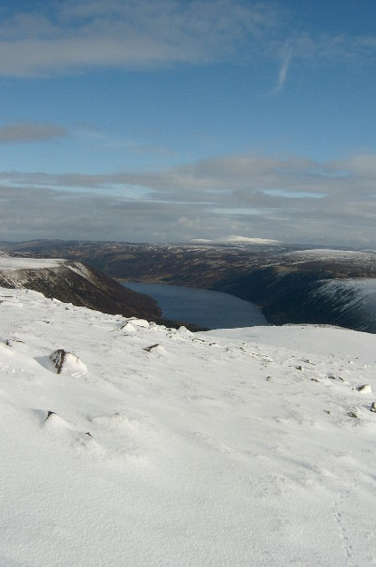 Snow, the trench of Loch Muich with Mount Keen in the distance