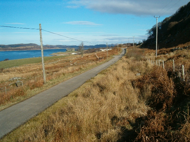 Road alongside Loch Sween, Castle Sween in the distance