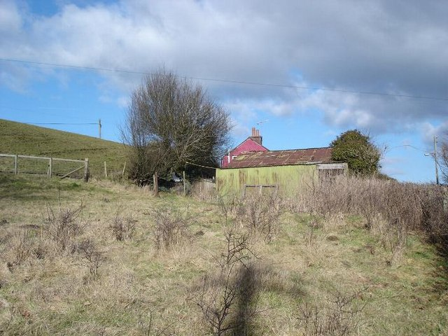 Cottage and hill