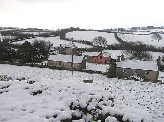 Treborough and church in the snow
