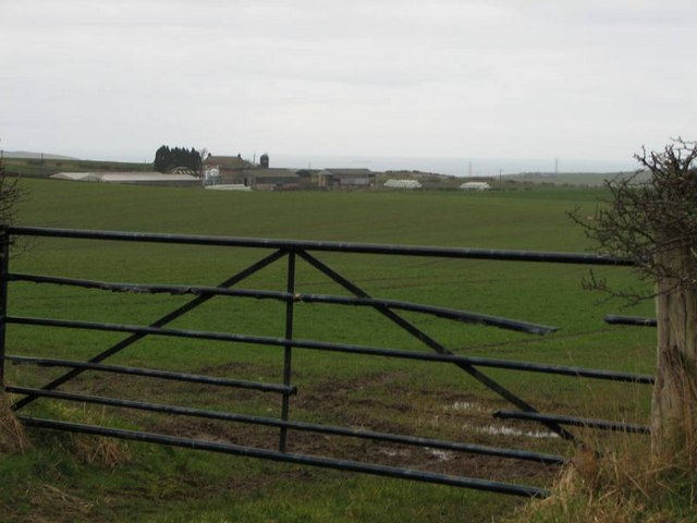 Looking through the gate across the field at Highfields Farm
