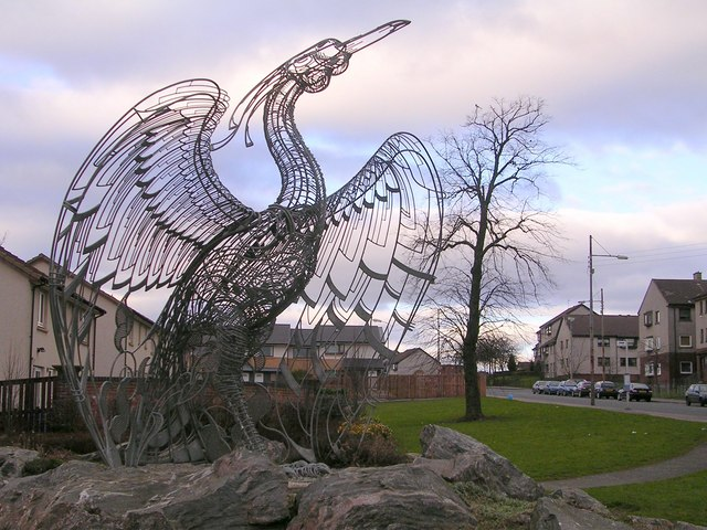 metal sculpture of phoenix rising from the ashes