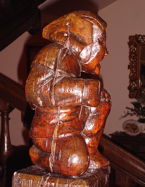 Carving on newel post, Eastwell Manor