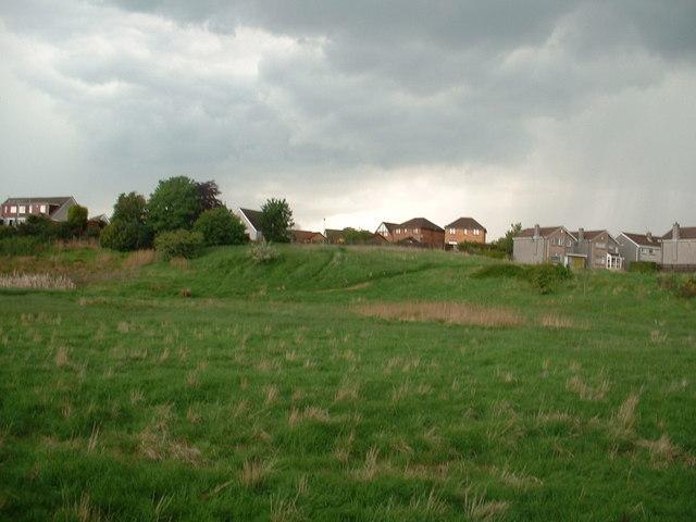 Housing overlooking open land adjacent to New Carron Road, Stenhousemuir
