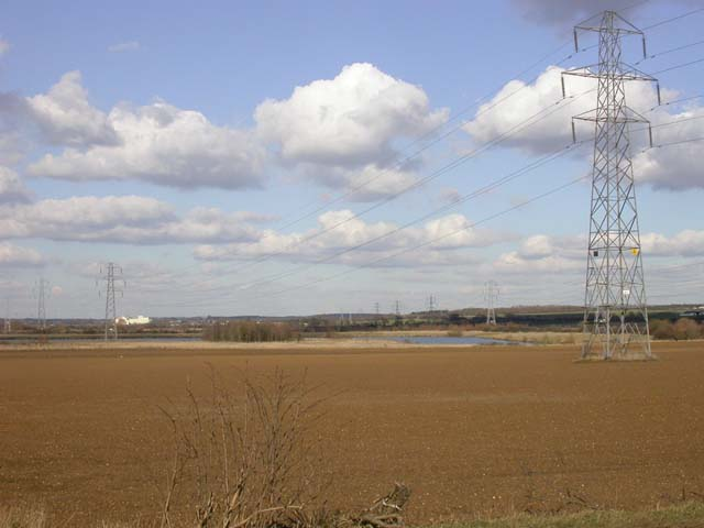 Lines of Pylons Meet on Approach to Sub-station