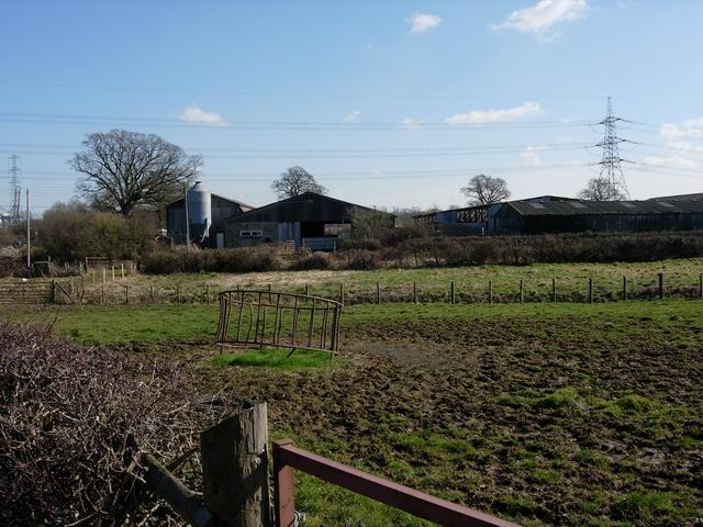 Muddy field and farm