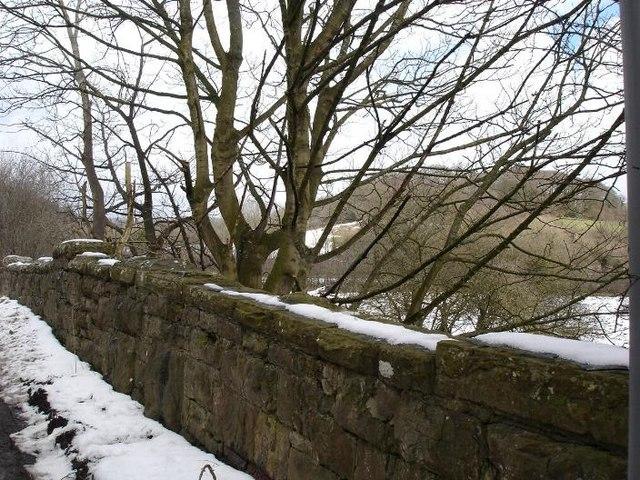 Snowy stone bridge