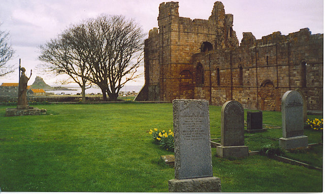 St Aidan's Statue and Lindisfarne Priory.