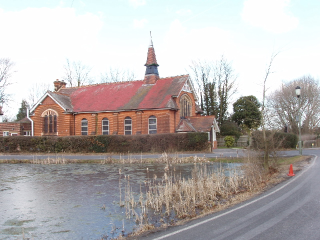 Pond and church, Mill Hill Village