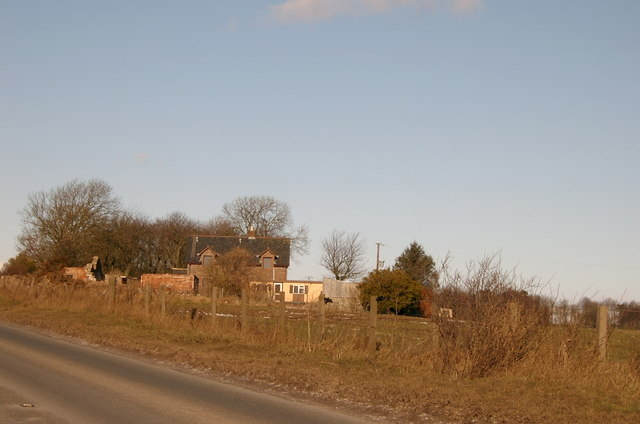 House close to the road with woodland