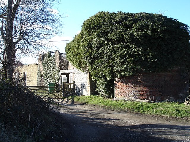 Derelict oast and barn