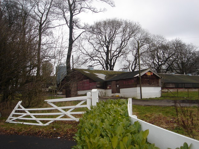Farm buildings behind Doorway to Value furniture store