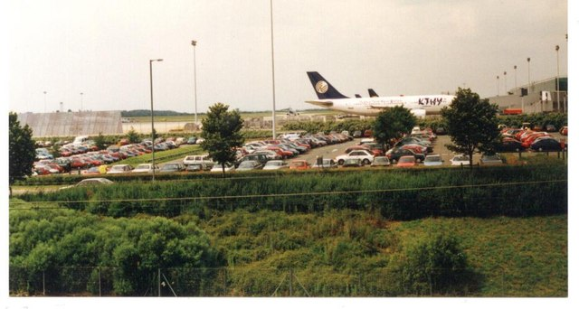Car park and planes at Stansted Airport