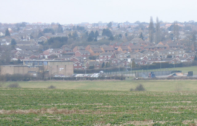 Desborough with its Leisure Centre from field near Rothwell