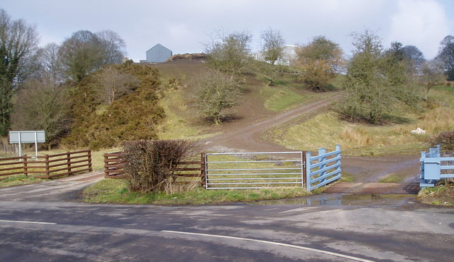 Two farm gates with cattle grids