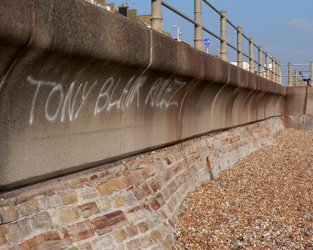 Sea defences with graffiti (ironic?)