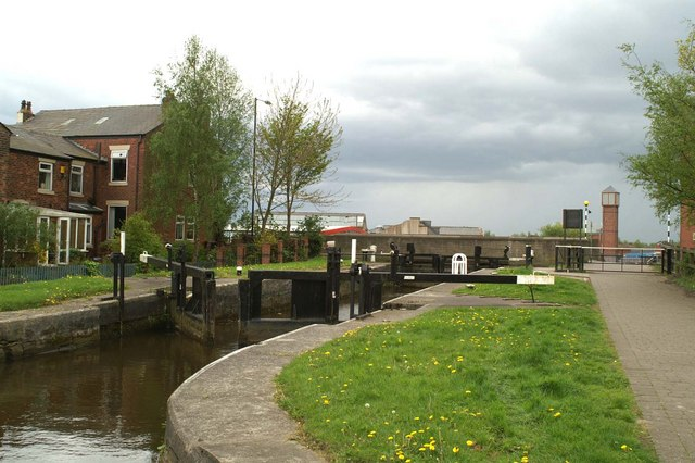 The eighth lock, with the A577 crossing Rose Bridge behind