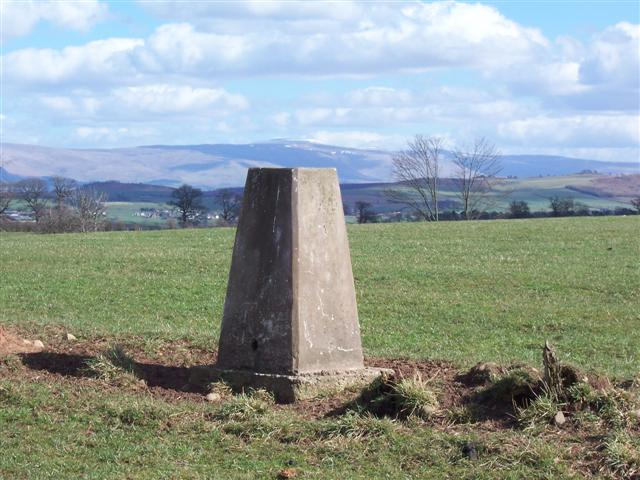 Trig Stone with Pennines.