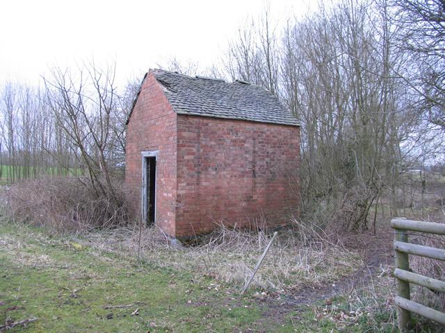 Small brick building in a field