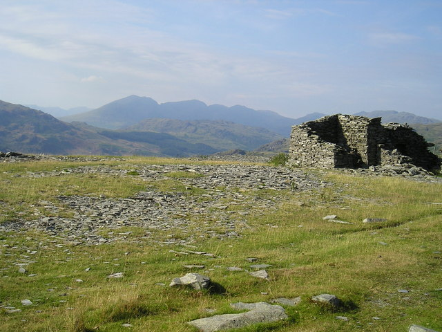Old quarry building with the Scafells in the distance