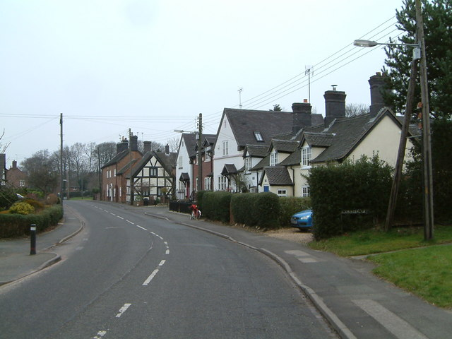 Betley- The main road, looking north, the postmans bike at rest