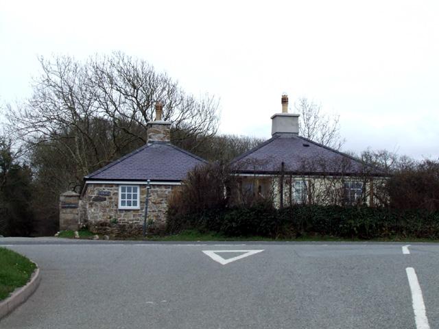 Lodge at estate entrance  beside a road junction