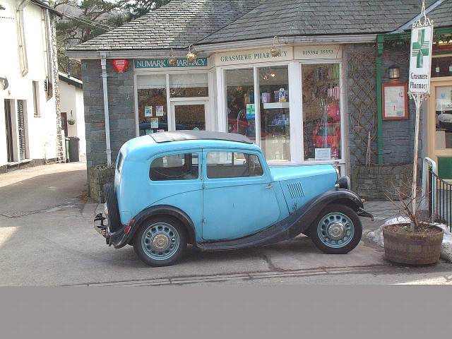 Old Morris (1932?)  outside Pharmacy in Grasmere