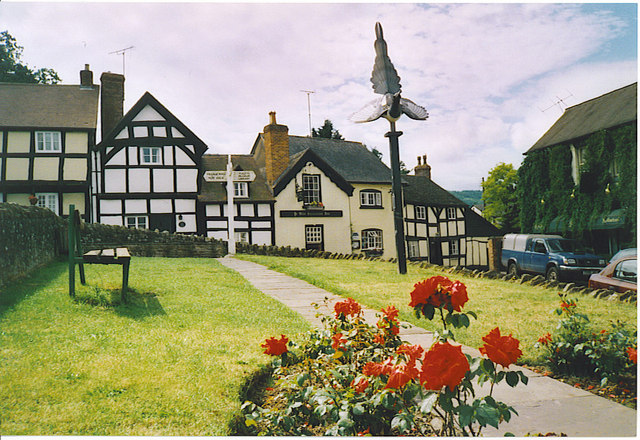 Weobley, Old Salutation Inn and Magpie Sculpture.