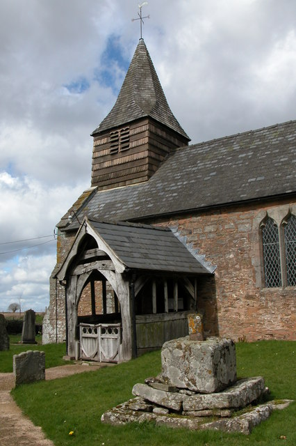 Dewsall Church and the remains of a cross
