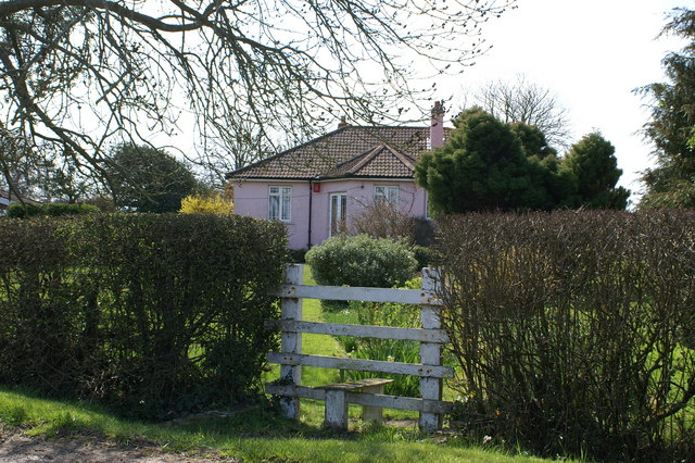 Pink house with a stile