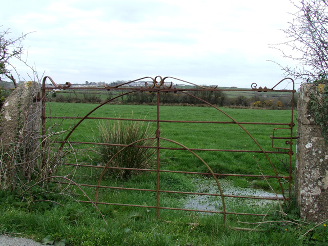 Iron gate leading into a field