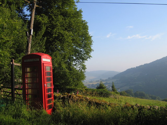 Rural phone box, leaning phone pole