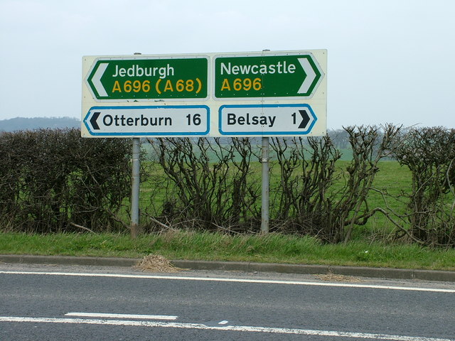 Road signs at the B6309, A696 junction